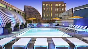 Outdoor pool, open 6 AM to 11 PM, pool umbrellas, pool loungers