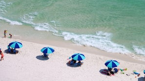 On the beach, white sand, beach cabanas, beach umbrellas