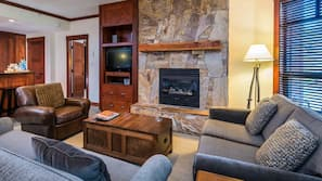 LCD TV, fireplace, DVD player, heated floors