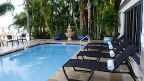 Outdoor pool, open 9:00 AM to 7:00 PM, sun loungers