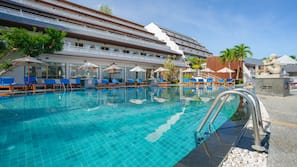 2 outdoor pools, open 8 AM to 7 PM, pool umbrellas, pool loungers