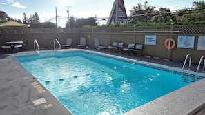 Seasonal outdoor pool, open 7:00 AM to 9:00 PM, pool umbrellas