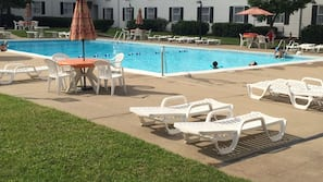 Indoor pool, seasonal outdoor pool, open 8 AM to 9 PM, pool umbrellas