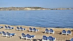 Beach nearby, beach umbrellas, beach towels, beach volleyball