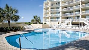 Indoor pool, seasonal outdoor pool, open 9 AM to 10 PM, pool umbrellas