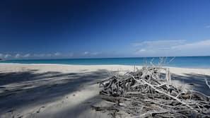 Private beach, white sand, free beach cabanas, sun loungers