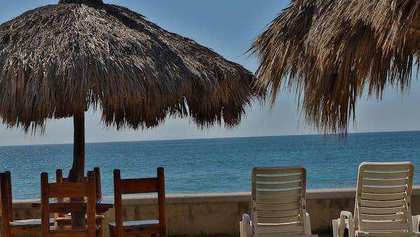 Private beach, free beach cabanas, beach umbrellas, beach towels