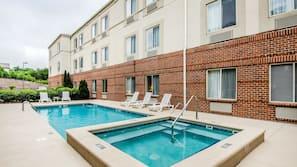 Seasonal outdoor pool, open 10 AM to 9 PM, pool umbrellas, pool loungers