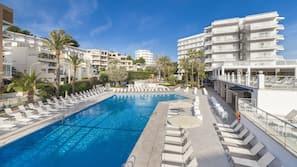 Outdoor pool, a rooftop pool, pool umbrellas
