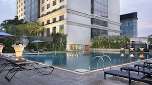 Outdoor pool, open 5:30 PM to 10 PM, pool umbrellas, sun loungers