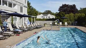 Seasonal outdoor pool, open 8:00 AM to 7:30 PM, pool umbrellas