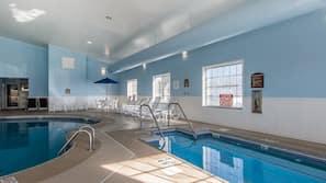 Indoor pool, open 7 AM to 10 PM, pool umbrellas