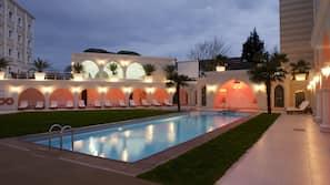 Seasonal outdoor pool, open 10:00 AM to 6:00 PM, free pool cabanas