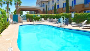 Outdoor pool, open 8 AM to 10 PM, pool umbrellas