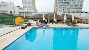 Indoor pool, outdoor pool, open 9 AM to 10 PM, pool umbrellas