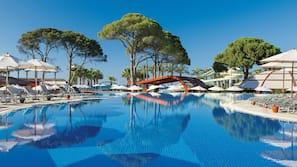 Indoor pool, 8 outdoor pools, open 8:00 AM to 7:30 PM, pool umbrellas