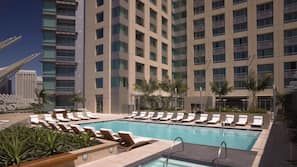 Outdoor pool, open 5:00 AM to 10:00 PM, pool loungers