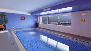 Indoor pool, open 9:00 AM to 9:00 PM, lifeguards on site