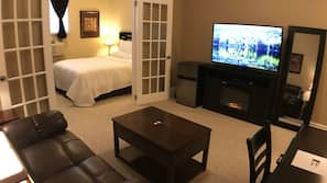 55-inch LED TV with cable channels, fireplace, first-run movies