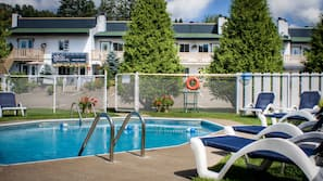 Outdoor pool, open 9 AM to 9 PM, pool umbrellas