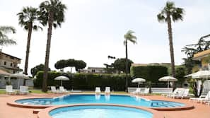 Seasonal outdoor pool, open 9:00 AM to 6:00 PM, pool umbrellas