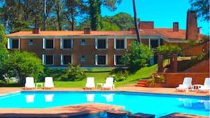 Seasonal outdoor pool, open 9:30 AM to 8:00 PM, pool umbrellas