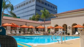 Outdoor pool, open 6 AM to 10 PM, cabanas (surcharge), pool umbrellas