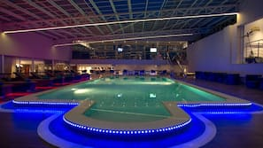 Indoor pool, outdoor pool, free pool cabanas, pool umbrellas