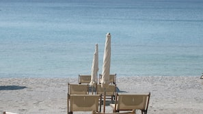 Private beach, sun-loungers, beach umbrellas, beach bar