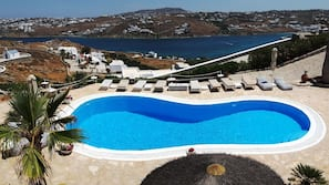 Seasonal outdoor pool, open 8:00 AM to midnight, pool umbrellas