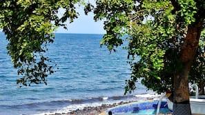 On the beach, black sand, beach towels, scuba diving