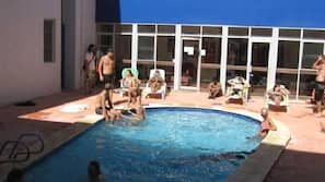 Outdoor pool, open 9:00 AM to 9:00 PM, pool loungers