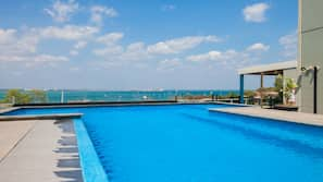 Outdoor pool, open 6:00 AM to 8:00 PM, pool loungers