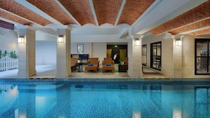 Indoor pool, pool umbrellas, pool loungers
