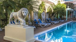 Outdoor pool, open 7:00 AM to 6:30 PM, pool umbrellas, pool loungers