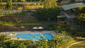 2 outdoor pools, open 8 AM to 6 PM, pool umbrellas