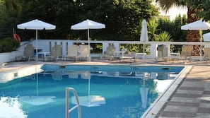 Outdoor pool, open 10:00 AM to 7:00 PM, pool umbrellas, pool loungers