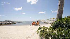 Private beach, white sand, free beach shuttle, beach umbrellas