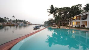 Outdoor pool, open 8 AM to 7 PM, pool loungers