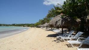 Private beach, white sand, sun-loungers