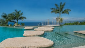 2 outdoor pools, an infinity pool, sun loungers