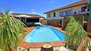 Seasonal outdoor pool, open 8 AM to 8:00 PM, pool umbrellas