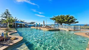 Outdoor pool, open 7:30 AM to 5:30 PM, pool umbrellas, pool loungers