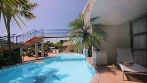 Seasonal outdoor pool, open 9 AM to 9 PM, pool umbrellas, pool loungers
