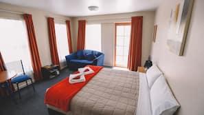 Premium bedding, laptop workspace, blackout curtains, iron/ironing board