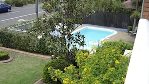 Seasonal outdoor pool, open 8:00 AM to 9:00 PM, pool umbrellas