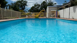 Seasonal outdoor pool, open 8:00 AM to 10:00 PM, pool loungers
