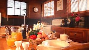 Full-sized fridge, hob, coffee/tea maker, cookware/dishes/utensils