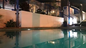 Outdoor pool, open 9 AM to 7 PM, pool loungers