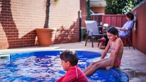 Outdoor pool, open 7:30 AM to 8:00 PM, pool loungers